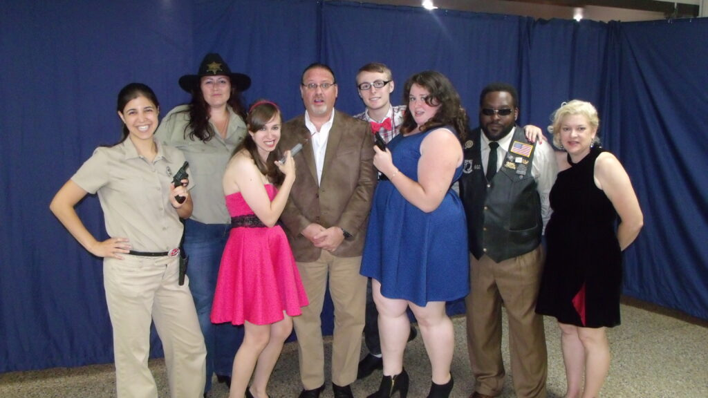 The cast from L-R: Jessica Braynor as Sylvia, Mandy Danberry as Sheriff Sammy, Angela Robb as Virginia, Matt Donohue as Rodney, Scott Sample as Chester, Elyse Emmerling as Milly, Tony Gladden as Richard, and Deb Lasky as Amanda. Directed by: Rob Michael Lasky